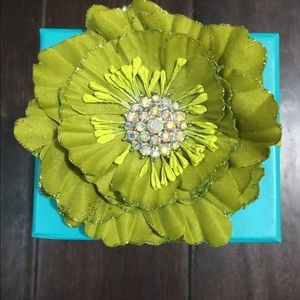 Empty Tieks boxes with chartreuse flower